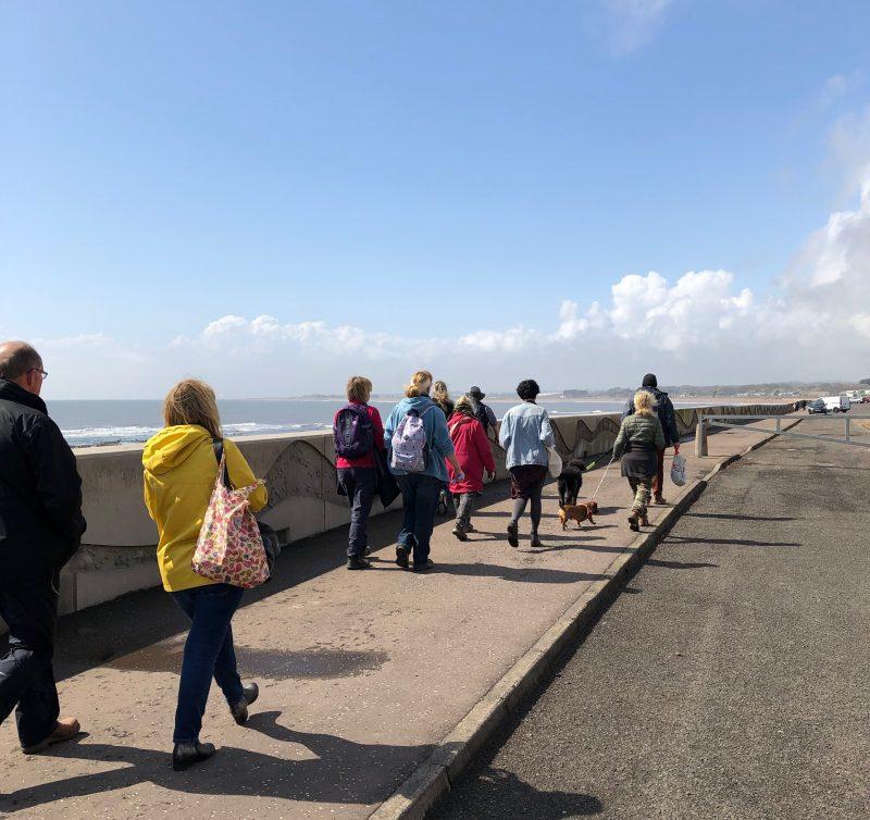 People walking along Arbroath beach front