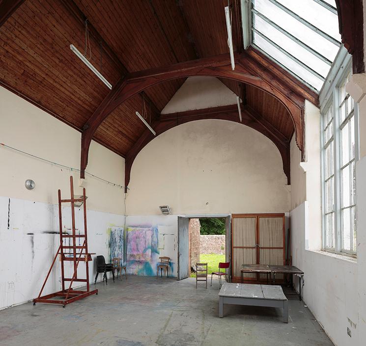Large open 1901 studio with doors open