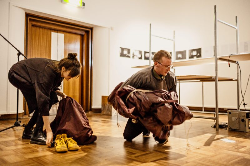 Cicecely Farrer and Gordon Douglas clearing up after a performance at Cooper Gallery. Photo: Ross Fraser McLean.