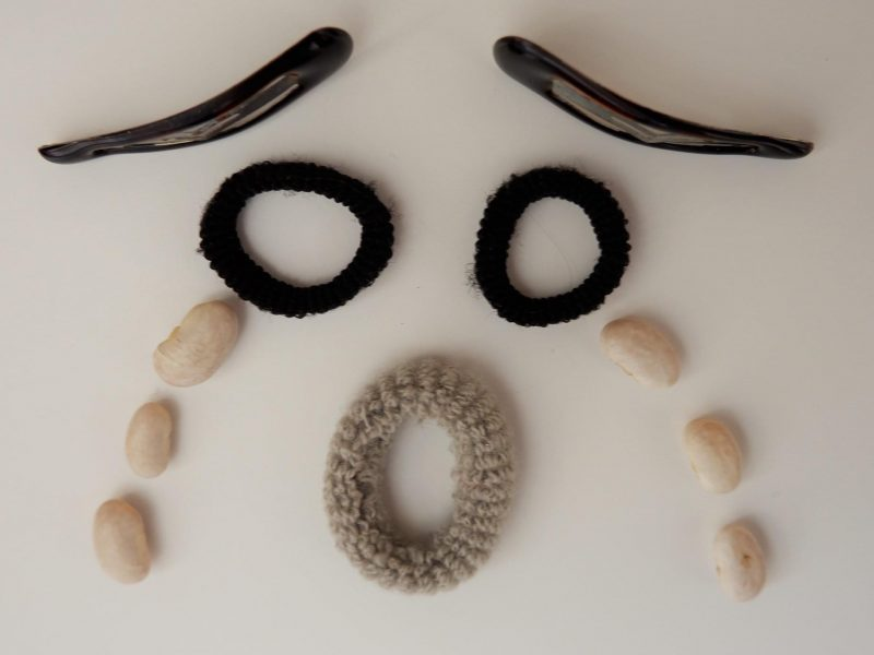 A weeping face made out of everyday objects
