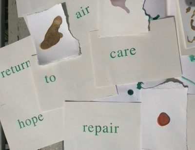 A pile of white paper with the words 'return', 'to', 'hope', 'air', 'care' and 'respair' and ink in different